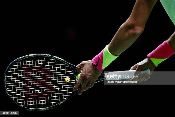 A detailed look at the ball wristband and racquet of Andrey Kuznetsov of Russia before serving to Milos Raonic of Canada during day 2 of the ABN AMRO...