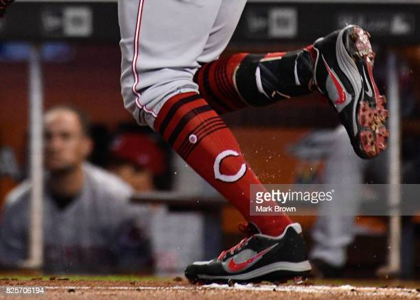 Detailed photo of Nike shoe and Stance sock of Joey Votto of the Cincinnati Reds in action during the game between the Miami Marlins and the...