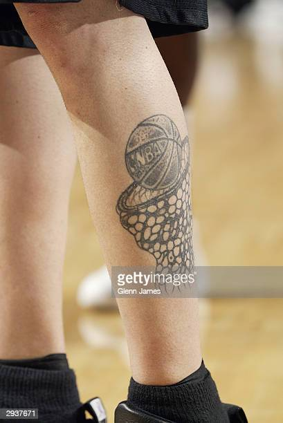 A detailed picture of Mike Bibby of the Sacramento Kings tattoo during the game against the Dallas Mavericks at the American Airlines Center in...