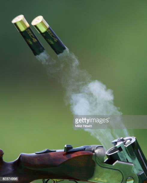A detailed picture of shells being ejected out of a shotgun during the men's skeet shooting qualification event at the Beijing Shooting Range Hall on...