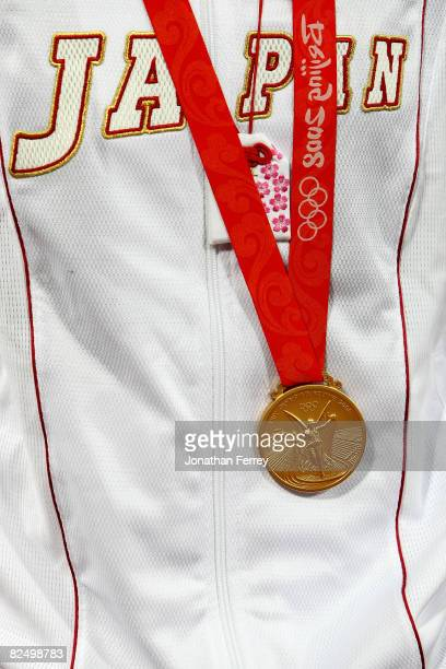 A detailed shot of a jersey with the gold medal of a Japanese player after Japan beat the United States 31 during the women's grand final gold medal...