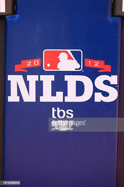 A detailed shot of the Major League Baseball NLDS logo on the outfield wall before Game 3 of the National League Division Series between the...