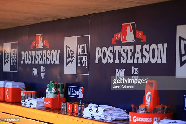 A detailed shot of the Major League Baseball postseason logo on the dugout wall before Game 3 of the National League Division Series between the...