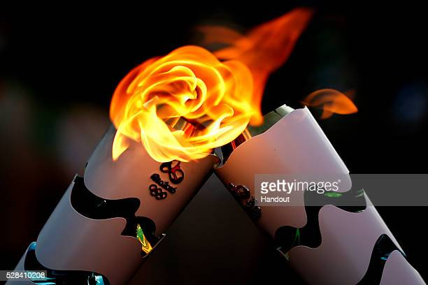 Detailed shot of the Olympic Torch during the Olympic Flame torch relay on May 3 2016 in Brasilia Brazil The Olympic torch will pass through 329...