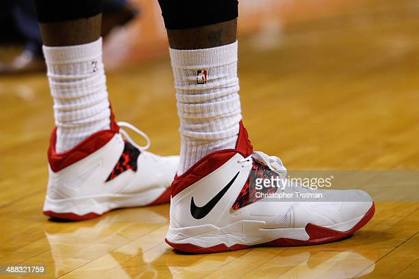 A detailed shot of the sneakers worn by LeBron James of the Miami Heat on court against the Toronto Raptors at American Airlines Arena on March 31...