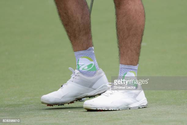 A detailed shot of Wesley Bryan of the United States' socks on the course during a practice round prior to the 2017 PGA Championship at Quail Hollow...