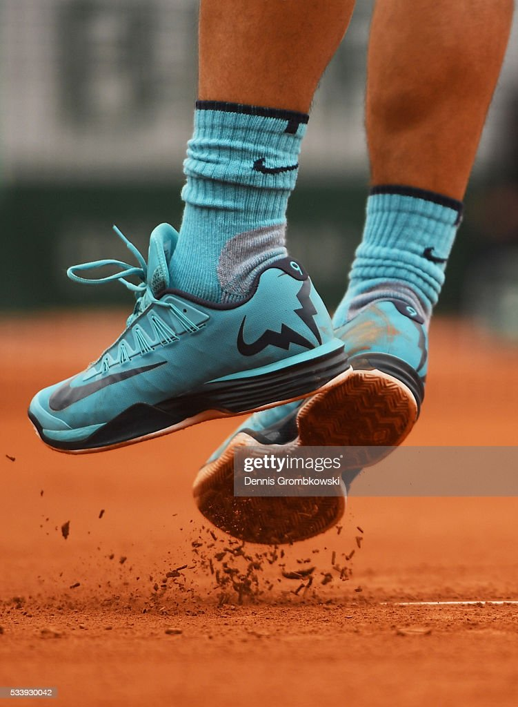 A detailed view as <a gi-track='captionPersonalityLinkClicked' href=/galleries/search?phrase=Rafael+Nadal&family=editorial&specificpeople=194996 ng-click='$event.stopPropagation()'>Rafael Nadal</a> of Spain serves during the Men's Singles first round match against Sam Groth of Australia on day three of the 2016 French Open at Roland Garros on May 24, 2016 in Paris, France.