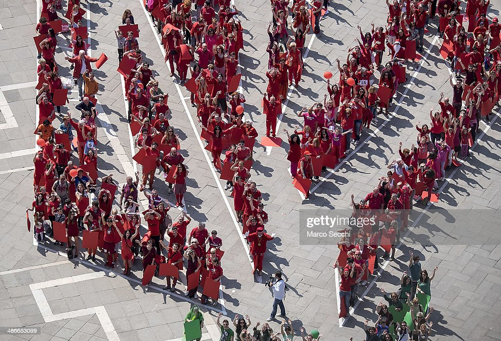 Detailed view from Saint Mark's Bell Tower of the human rosebud created on April 25, 2014 in Venice, Italy. One thousand venetians gathered today in Saint Mark's Square to form a giant rosebud of more than 1000 square meters to celebrate the Festa del Bocolo, when the Venetian males give a bocolo (a blooming red rose) to their women to show their love.