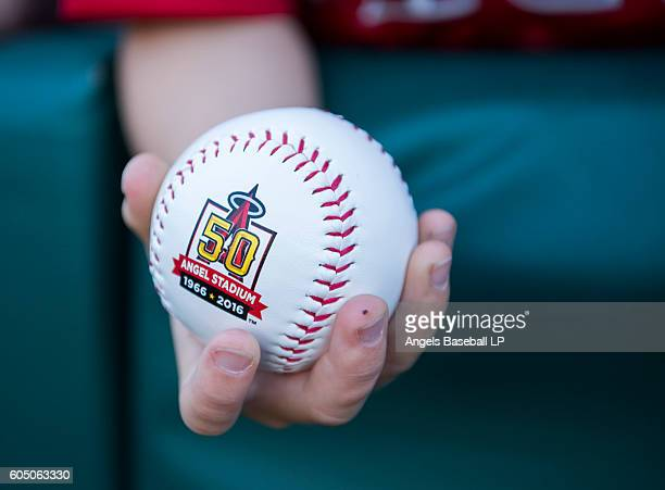 A detailed view of a baseball bearing an Angel Stadium fiftieth anniversary logo before the game between the Texas Rangers and the Los Angeles Angels...