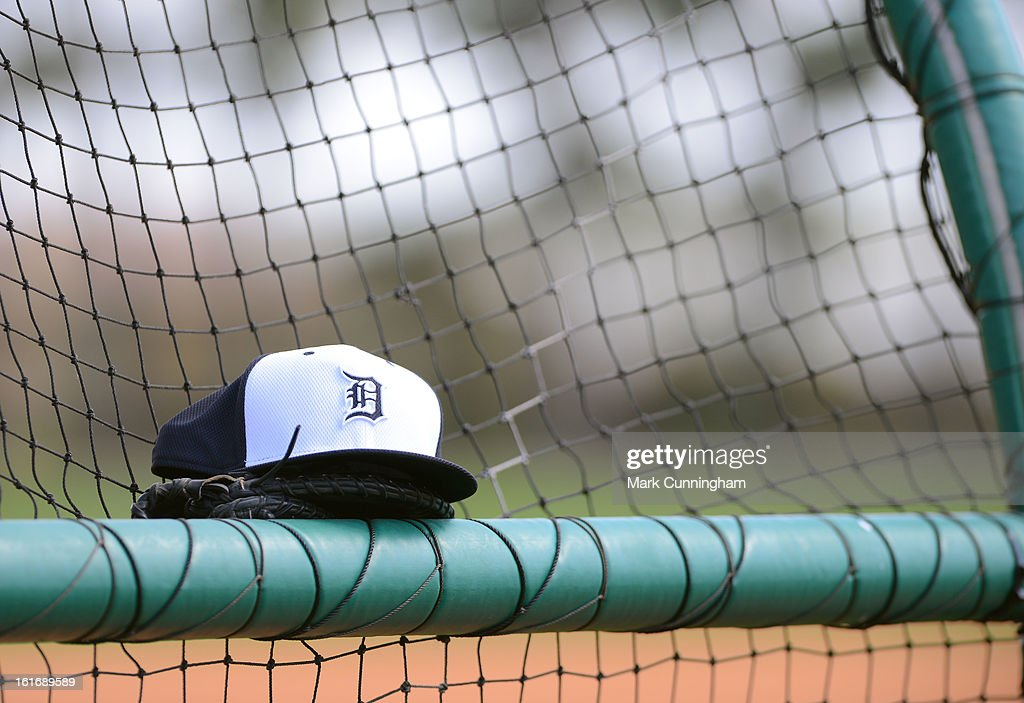 A detailed view of a Detroit Tigers Spring Training baseball hat sitting on the batting cage during workouts at the TigerTown Facility on February 13, 2013 in Lakeland, Florida.