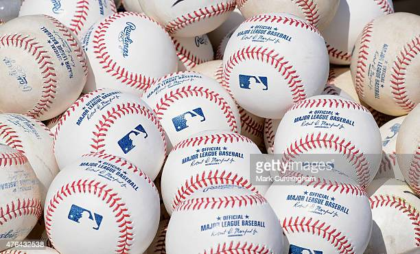 A detailed view of a group of Rawlings official baseballs with the signature of Major League Baseball Commissioner Robert D Manfred Jr prior to the...