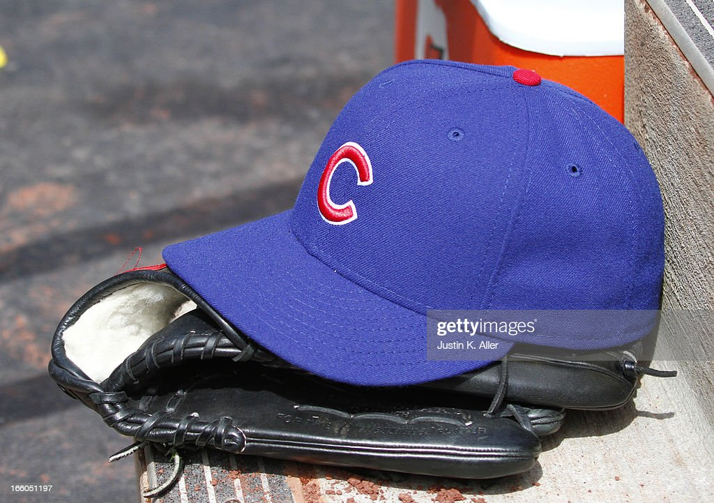 A detailed view of a hat and glove during the game between the Pittsburgh Pirates and the Chicago Cubs on April 4, 2013 at PNC Park in Pittsburgh, Pennsylvania.