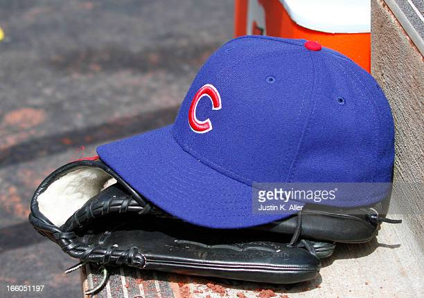 A detailed view of a hat and glove during the game between the Pittsburgh Pirates and the Chicago Cubs on April 4 2013 at PNC Park in Pittsburgh...