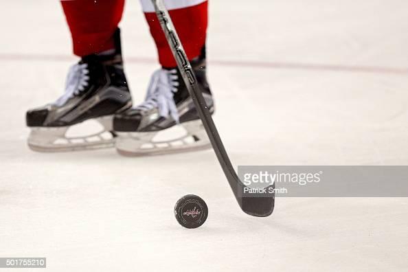 A detailed view of a ice hockey puck as the Washington Capitals play the Ottawa Senators at Verizon Center on December 16 2015 in Washington DC