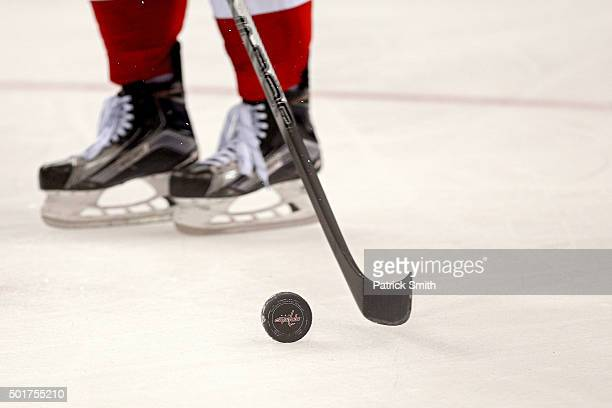 A detailed view of a ice hockey puck as the Washington Capitals play the Ottawa Senators at Verizon Center on December 16 2015 in Washington DC