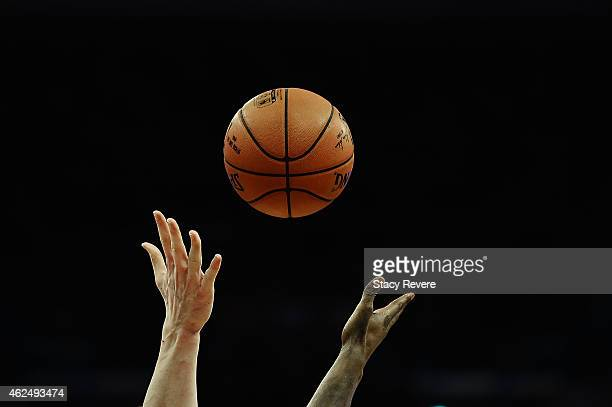 Detailed view of a jump ball between Omer Asik of the New Orleans Pelicans and Wilson Chandler of the Denver Nuggets during the first half of a game...