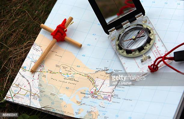 A detailed view of a map compass and cross as pilgrims walk with crosses as the Northern Cross pilgrimage makes it's final leg of its journey to Holy...
