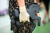 A detailed view of a Myer Fashions on the Field entrant's purse and glove is seen on Crown Oaks Day at Flemington Racecourse on November 5 2015 in...