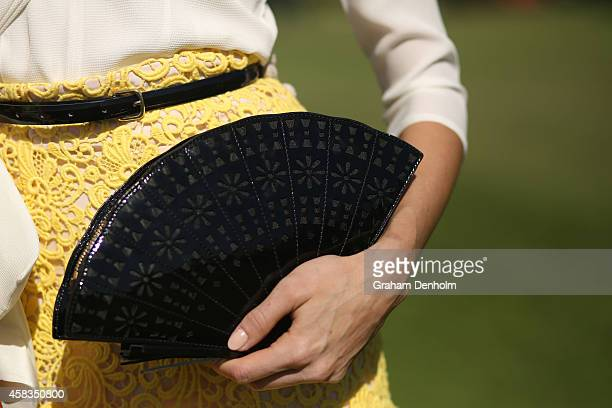 A detailed view of a Myer Fashions on the Field entrant's purse is seen in the Fashion on the Field enclosure on Melbourne Cup Day at Flemington...
