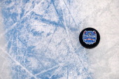 A detailed view of a puck is seen on the ice during the 2014 NHL Stadium Series practice day at Soldier Field on February 28 2014 in Chicago Illinois