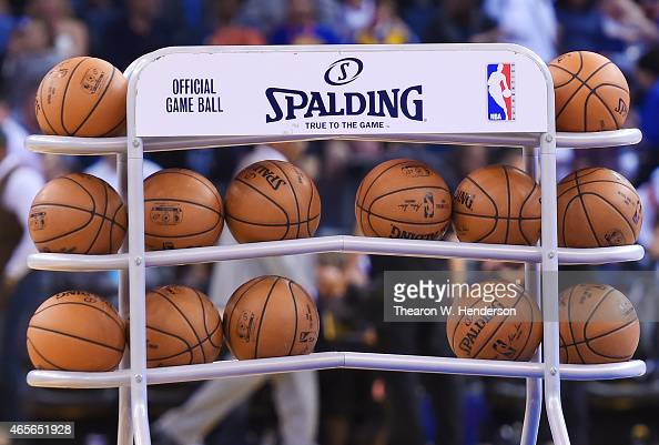 A detailed view of a rack of Spalding NBA basketball sitting at half court prior to the start of the second half of the game between the Los Angeles...