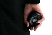 A detailed view of a referee holding a puck during Game Three of the Eastern Conference Finals between the Tampa Bay Lightning and the New York...