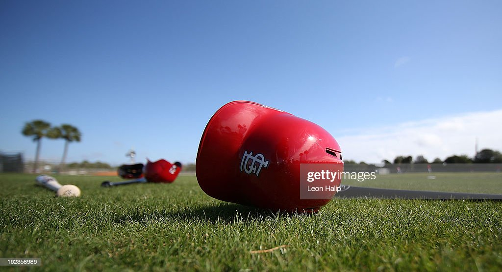 A detailed view of a St. Louis Cardinals batting helmet on the ground during spring training on February 20, 2013 in Jupiter, Florida.