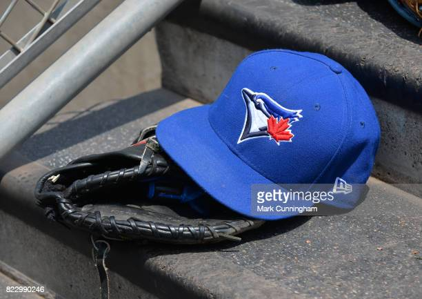A detailed view of a Toronto Blue Jays baseball hat and glove sitting on the dugout steps during the game against the Detroit Tigers at Comerica Park...