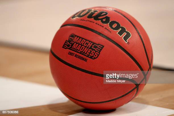 A detailed view of a Wilson Basketball with a NCAA March Madness logo on it during the first half between the Wisconsin Badgers and the Florida...