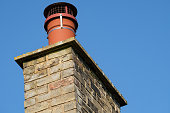 The cap on the chimney prevents birds from nesting in the smoke stack, as the household has a real fire and thus helps prevent any fire issues.