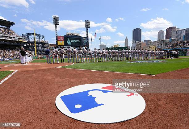 A detailed view of an MLB logo on the field as teams line up for pregame ceremonies prior to the Opening Day game between the Detroit Tigers and the...