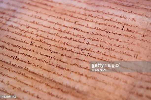 A detailed view of an original Magna Carta copy from Lincoln Cathedral is pictured during a photocall at the British Library in London on February 2...