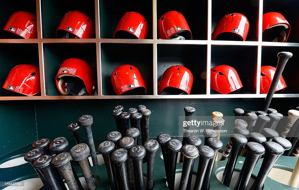 A detailed view of bats and batting helmets belonging to the Cincinnati Reds sitting in the racks before a Major League Baseball game between the Cincinnati Reds and San Francisco Giants at AT&T Park on July 23, 2013 in San Francisco, California.