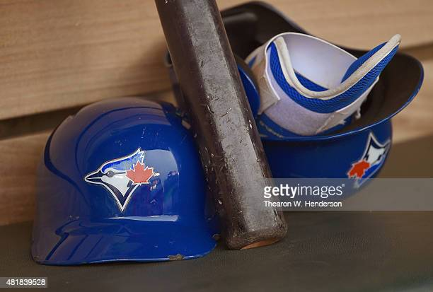 A detailed view of batting helmets and bat belonging to Russell Martin of the Toronto Blue Jays sitting in the dugout prior to the start of the game...