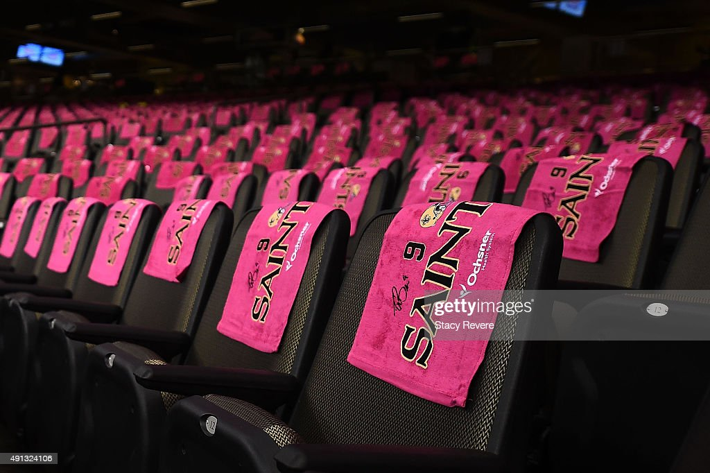 Detailed view of breast cancer awareness towels covering seats in the Mercedes-Benz Superdome prior to a game between the Dallas Cowboys and the New Orleans Saints on October 4, 2015 in New Orleans, Louisiana.