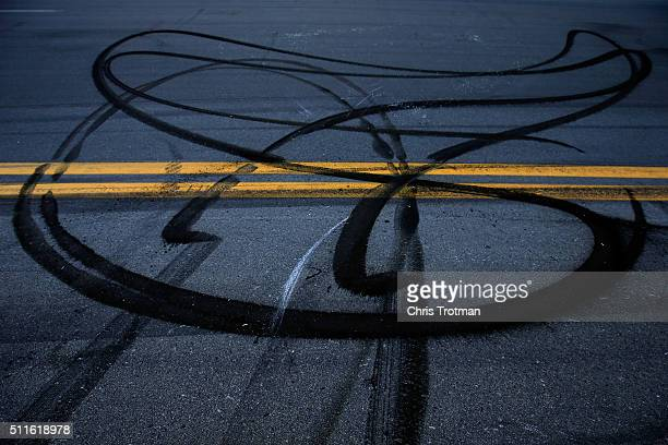 A detailed view of burned rubber on the track after a burnout by Denny Hamlin driver of the FedEx Express Toyota after the NASCAR Sprint Cup Series...