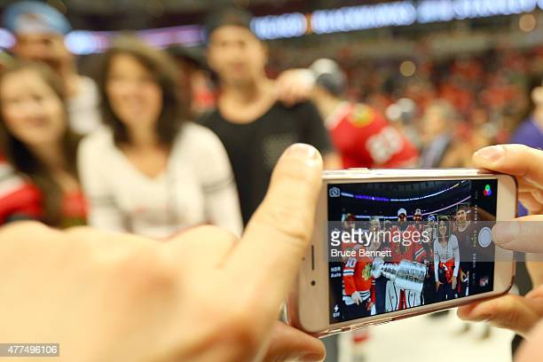 A detailed view of Corey Crawford of the Chicago Blackhawks poses with his family after defeating the Tampa Bay Lightning by a score of 20 in Game...