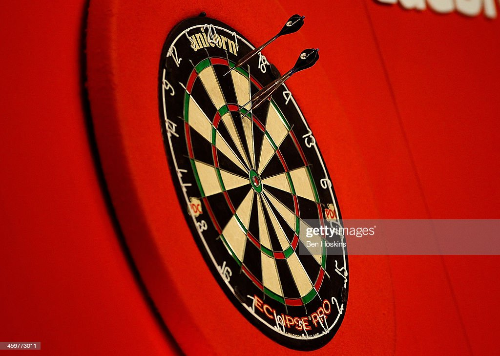 Detailed view of darts in the board on day fifteen of the Ladbrokescom World Darts Championship at Alexandra Palace on December 30 2013 in London...