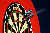 A detailed view of darts in the dartboard during Day Seven of the William Hill PDC World Darts Championships at Alexandra Palace on December 27 2014...