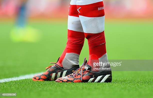 A detailed view of football boots with rainbow laces during the Barclays Premier League match between Arsenal and Manchester City at Emirates Stadium...