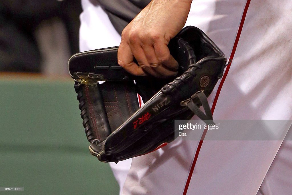 A detailed view of Jon Lester #31 of the Boston Red Sox glove as he leaves the game in the eighth inning against the St. Louis Cardinals during Game One of the 2013 World Series at Fenway Park on October 23, 2013 in Boston, Massachusetts.