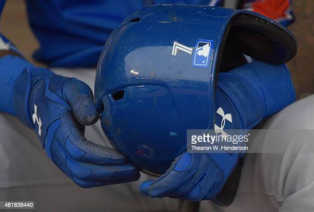 A detailed view of Jose Reyes of the Toronto Blue Jays wearing Under Armour batting gloves while holding onto his batting helmet prior to the start...
