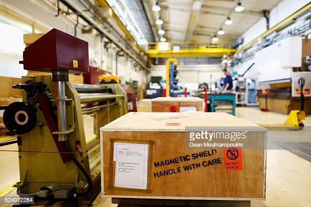 A detailed view of orders deliveries and requests with a large box stamped with a 'Magnetic Sheield Handle with Care' warning on the side in Building...