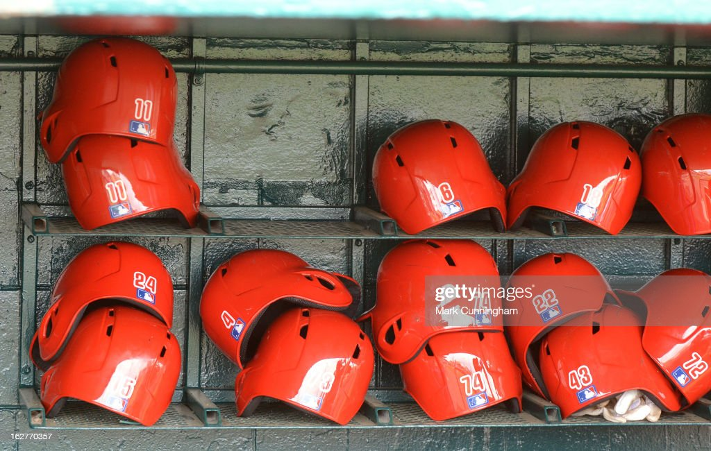 A detailed view of Philadelphia Phillies batting helmets in the dugout prior to the spring training game against the Detroit Tigers at Joker Marchant Stadium on February 24, 2013 in Lakeland, Florida. The game ended in a 10 inning 5-5 tie.