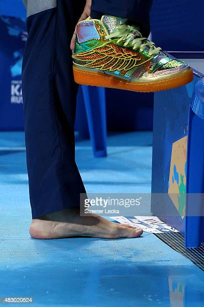 A detailed view of Ryan Lochte of the United States taking off his sneakers prior to the Men's 200m Individual Medley SemiFinals on day twelve of the...