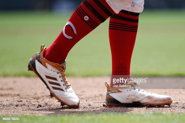 Detailed view of shoes worn in honor of Jackie Robinson Day by Zack Cozart of the Cincinnati Reds during a game against the Milwaukee Brewers at...