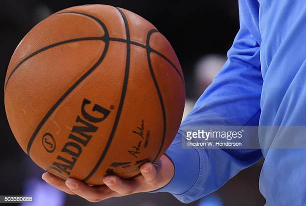 A detailed view of Spalding NBA basketballs held onto by Kostas Papanikolaou of the Denver Nuggets prior to playing the Golden State Warriors in an...