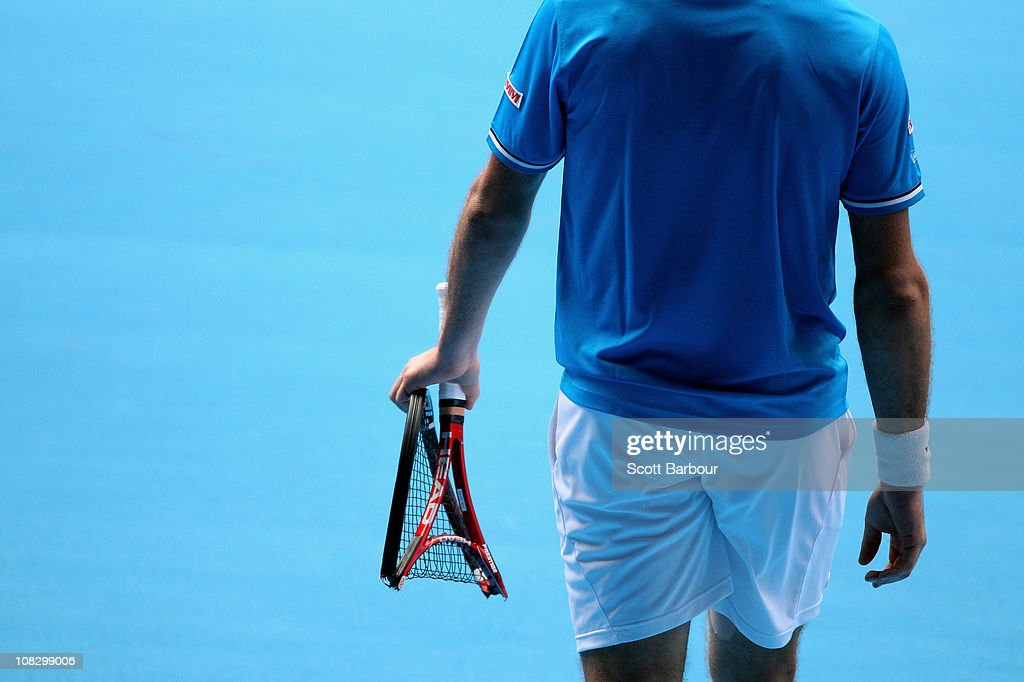 A detailed view of <a gi-track='captionPersonalityLinkClicked' href=/galleries/search?phrase=Stanislas+Wawrinka&family=editorial&specificpeople=557155 ng-click='$event.stopPropagation()'>Stanislas Wawrinka</a> of Switzerland's broken racquet in his quarter final match against Roger Federer of Switzerland during day nine of the 2011 Australian Open at Melbourne Park on January 25, 2011 in Melbourne, Australia.