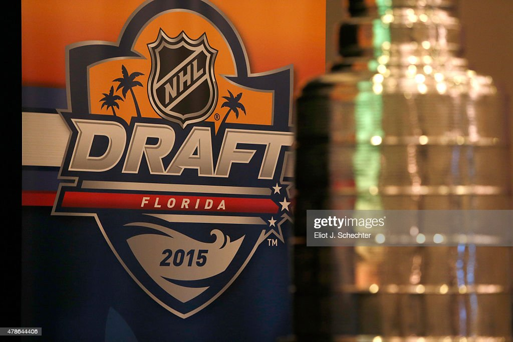 A detailed view of the 2015 NHL Draft logo and the Stanley Cup is seen at the commissioner's luncheon at Ritz Carlton on June 26 2015 in Ft...