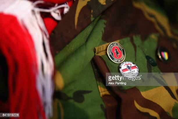 A detailed view of the badges on a jacket of one of the members of the Clapton Ultras during The Emirates FA Cup Qualifying First Round match between...